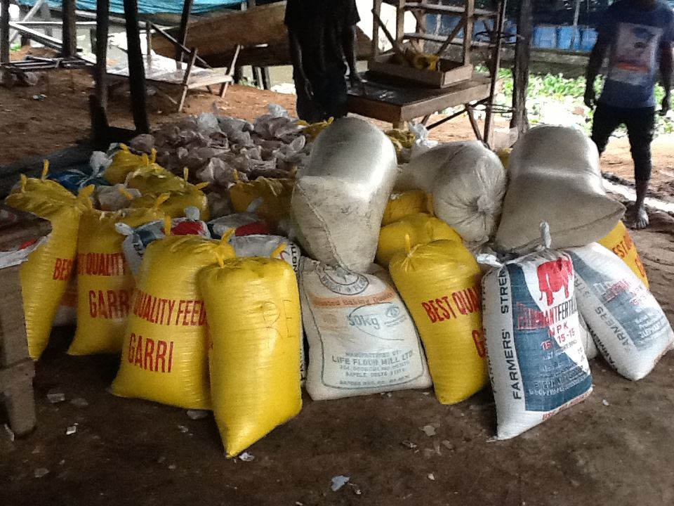 Bags of Garri at Warri waterside ready to be ferried by boat to Oporoza community for the relief programme