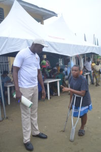 A physically challenged girl being attended to during an outreach