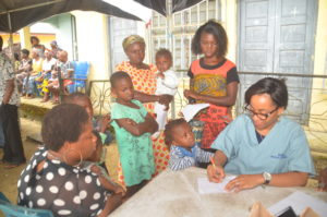 Doctor attending to Nursing mothers and children