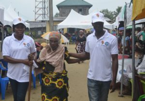 Aged woman being assisted to the ophthalmic unit to be attended to